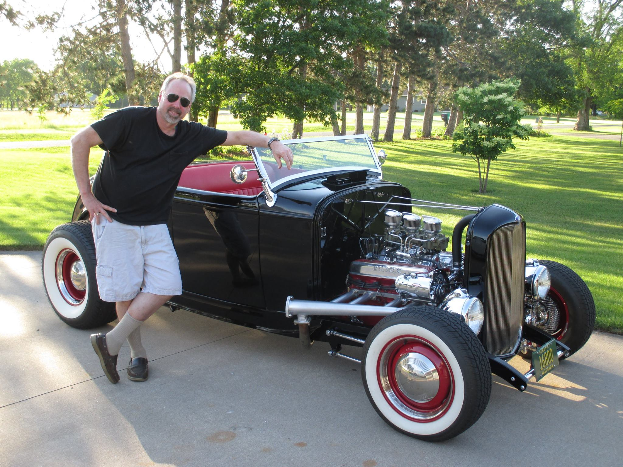 A proud Scott standing next to his Nailhead powered Hot Rod